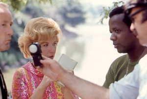 William Greaves works with the actors while the crew prepares a shot in Symbiopsychotaxiplasm: Take One (1968)