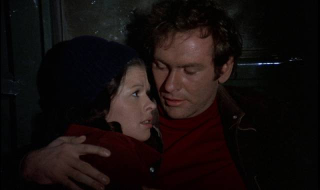 David (Will MacMillan) and his pregnant girlfriend Judy (Lane Carroll) desperately try to escape in George A. Romero's The Crazies (1973)