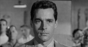 Alan Marshall (Kerwin Mathews) smells corruption in the family business in Robert Aldrich/Vincent Sherman's The Garment Jungle (1957)