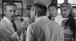 Walter Mitchell (Lee J. Cobb) argues about the union with his partner Fred Kenner (Robert Ellenstein) in Robert Aldrich/Vincent Sherman's The Garment Jungle (1957)