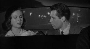 Alan Marshall (Kerwin Mathews) tries to protect Tulio Renata (Robert Loggia)'s wife Theresa (Gia Scala) and baby in Robert Aldrich/Vincent Sherman's The Garment Jungle (1957)