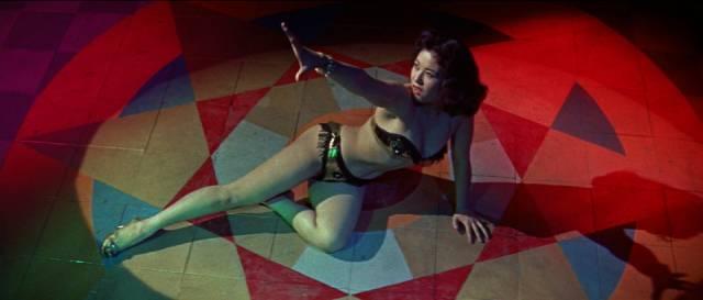 Nightclub performer Chikako Arai (Yumi Shirakawa) is mixed up with gangsters and monsters in Ishiro Honda's The H-Man (1958)