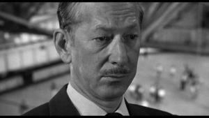 Th Man (Vaughn Taylor) is not happy to be seen by Dancer (Eli Wallach) in Don Siegel's The Lineup (1958)