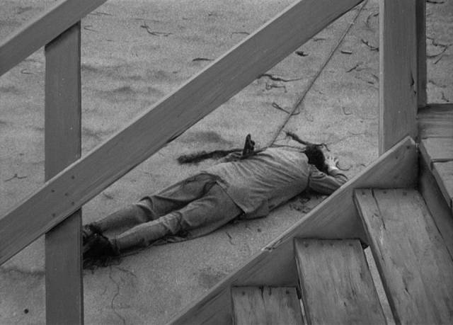 Accident or murder, Ted Darby (Sheppard Strudwick)'s body poses a problem for Lucia (Joan Bennett) in Max Ophuls' The Reckless Moment (1949)