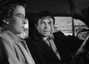 Donnelly (James Mason), a loan shark's henchman, shows up to blackmail Lucia (Joan Bennett) in Max Ophuls' The Reckless Moment (1949)