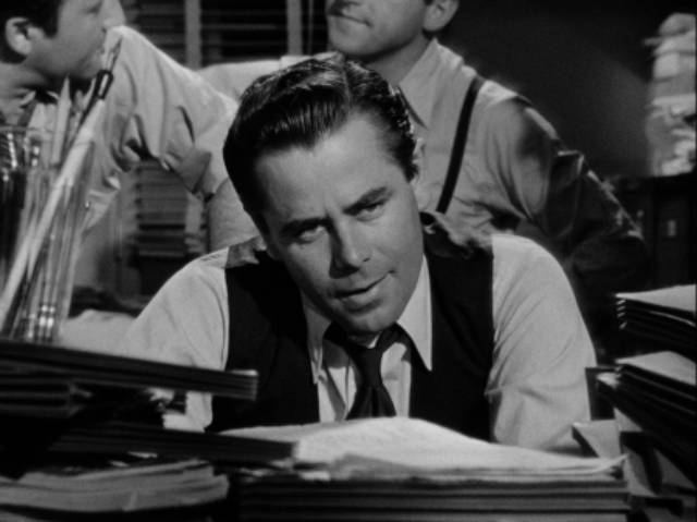 Frank Warren (Glenn Ford) pores over financial records in Joseph H. Lewis' The Undercover Man (1949)