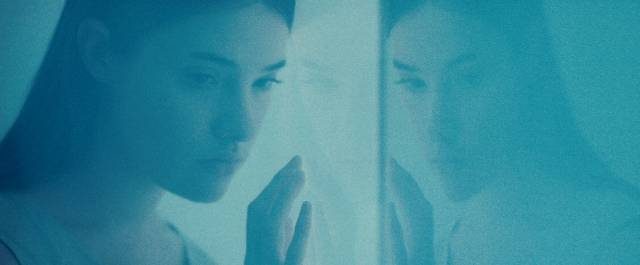 Psychic Elena (Eva Allan) is trapped in a research lab in Panos Cosmatos' Beyond the Black Rainbow (2010)