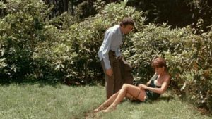 The hosts abandon their guests for a quickie in the bushes in Luis Bunuel's The Discreet Charm of the Bourgeoisie (1972)