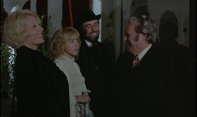 Friends gather for dinner at a friend's house on the wrong day in Luis Bunuel's The Discreet Charm of the Bourgeoisie (1972)