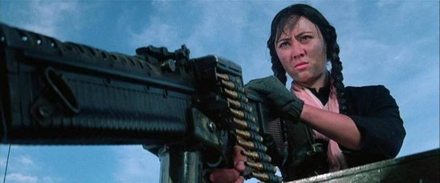 Tough Cambodian guerrillas lead the team to a secret weapons cache in Sammo Hung's Eastern Condors (1987)