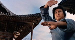 Husker (Sammo Hung) trains at the Shao-lin Temple in Sammo Hung's The Iron-Fisted Monk (1977)