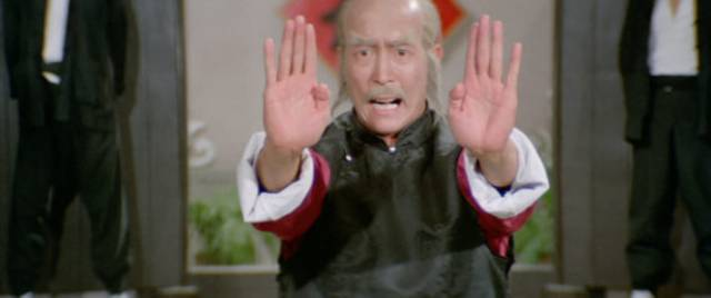 Master Ko (Lee Hoi-sang) uses the power of his deadly palms in Yuen Woo-ping's The Magnificent Butcher (1979)