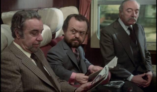 Fellow passengers take an interest in Mathieu (Fernando Rey)'s behaviour in Luis Bunuel's That Obscure Object of Desire (1977)