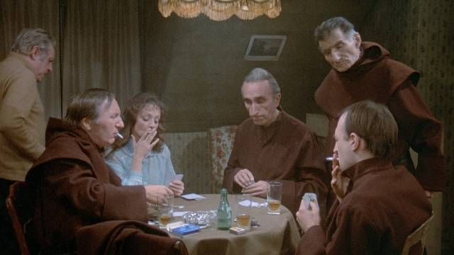 After prayer, the monks enjoy a game of poker in the nurse's room in Luis Bunuel's The Phantom of Liberty (1974)