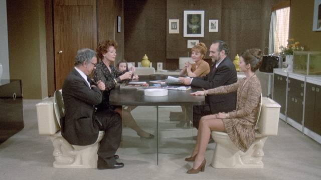 Defecation is a social activity while eating is shamefully hidden in Luis Bunuel's The Phantom of Liberty (1974)