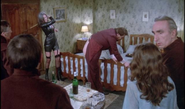 The businessman (Michael Lonsdale) enjoys public humiliation from his dominatrix (Anne-Marie Deschodt) in Luis Bunuel's The Phantom of Liberty (1974)