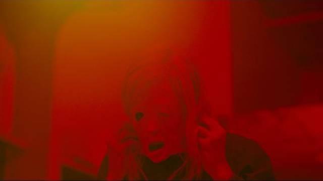 Tasya Voss (Andrea Riseborough)'s identity begins to disintegrate in Brandon Cronenberg's Possessor (2019)