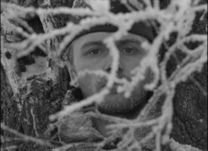 Wounded and dying, Sotnikov (Boris Plotnikov) seems to melt into nature in Larisa Shepitko's The Ascent (1977)