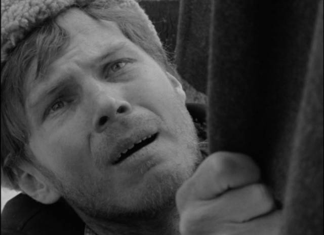 ... while Rybak (Vladimir Gostyukhin) is tormented by his betrayal in Larisa Shepitko's The Ascent (1977)