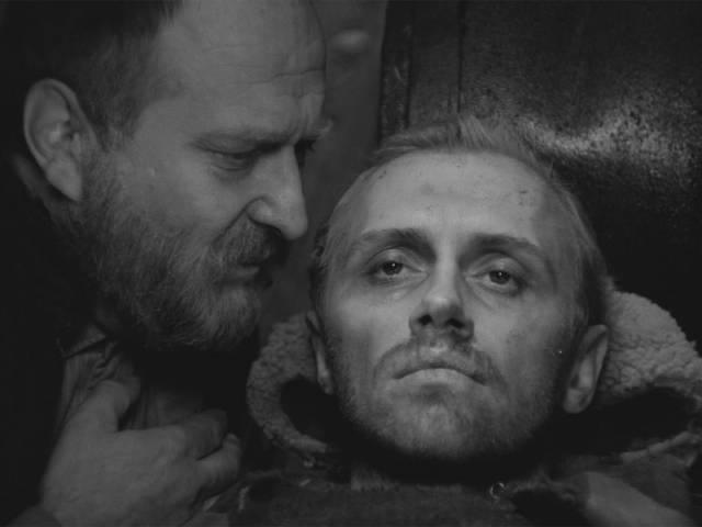 The elder (Sergey Yakoviev) bears witness to Sotnikov (Boris Plotnikov)'s suffering in Larisa Shepitko's The Ascent (1977)