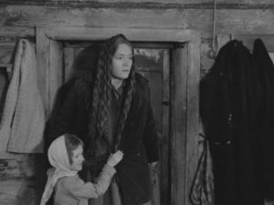 Demchikha (Lyudmila Polyakova) discovers the partisans hiding in her house in Larisa Shepitko's The Ascent (1977)