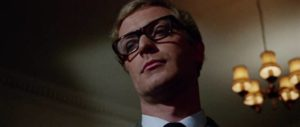 Harry Palmer (Michael Caine) exudes disdain from his superiors in Sidney J. Furie's The Ipcress File (1965)
