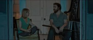 Waiting for the creature to appear, Ben (Jeremy Gardner) and Abby (Brea Grant) discuss their relationship in Jeremy Gardner and Christian Stella's After Midnight (2019)