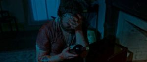 Ben (Jeremy Gardner) takes on the monster with his bare hands in Jeremy Gardner and Christian Stella's After Midnight (2019)