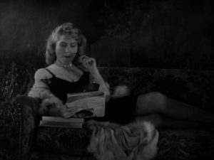 The Gamin's mother shows contempt for her father, triggering violence in John Parker's Dementia (1953)