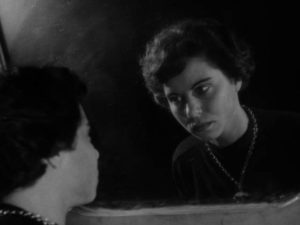 The Gamin (Adrienne Barrett) is haunted by family violence in John Parker's Dementia (1953)