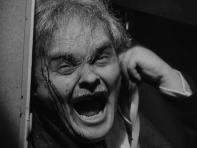 The Gamin (Adrienne Barrett)'s victim (Bruno Ve Sota) returns to taunt her in John Parker's Dementia (1953)