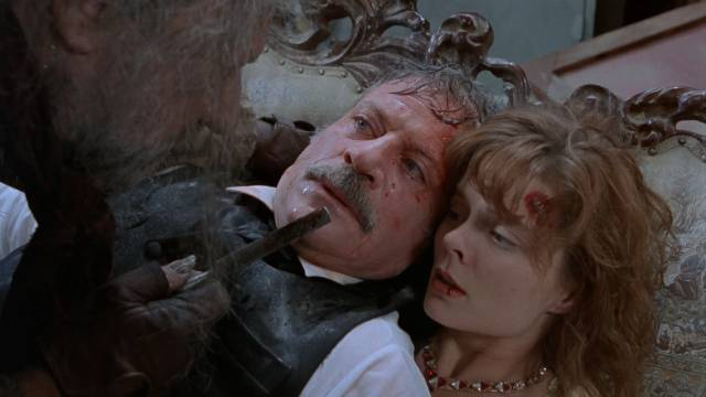 Molly McNulty (Romy Windsor) and Roderick Usher (Oliver Reed) are attacked by crazy Walter Usher (Donald Pleasence) in Andrew Birkinshaw's The House of Usher (1989)