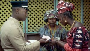 The postman delivers a money order to Ibrahim's wives in Ousmane Sembene's Mandabi (1968)