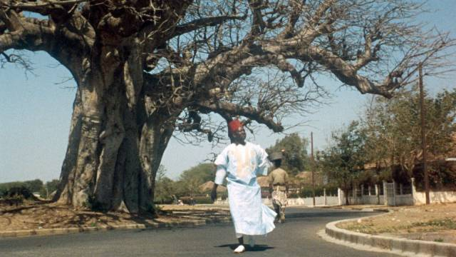 Ibrahim (Makhouredia Gueye), lacking bus fare, has to walk around the city in his quest for official ID in Ousmane Sembene's Mandabi (1968)