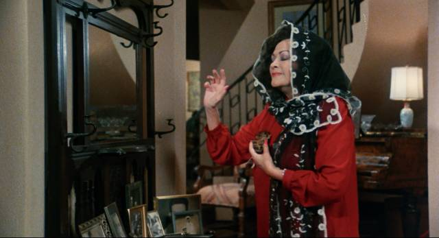 Aunt Hester (Yvonne De Carlo) uses witchcraft to eliminate her relatives in Peter Wittman's Play Dead (1983)