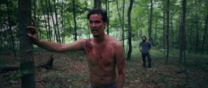 Mickey (Adam Cronheim) is traumatized after a hand-to-hand fight with a zombie in Jeremy Gardner's The Battery (2012)
