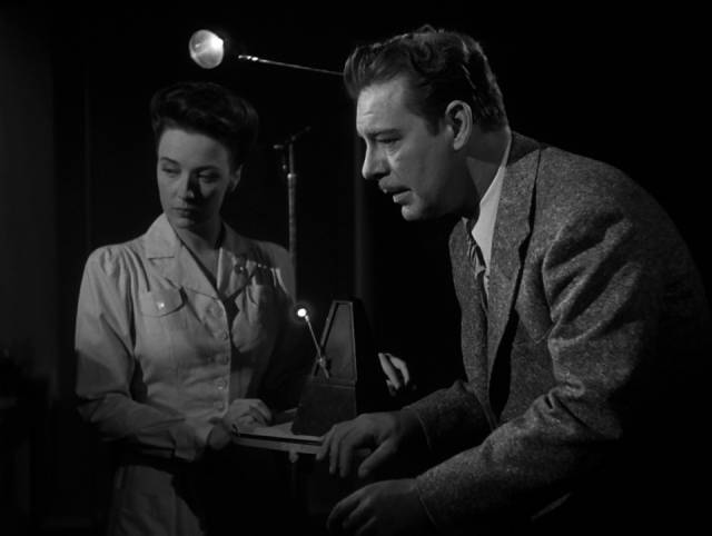 Dr. Mark Steele (Chaney) uses hypnotism to fix psychological problems in Reginald Le Borg's Calling Dr. Death (1943)