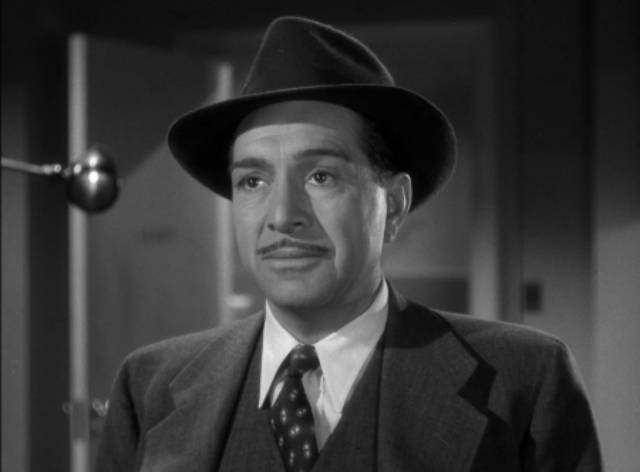 Inspector Gregg (J. Carroll Naish) investigates the murder of Dr. Mark Steele's wife in Reginald Le Borg's Calling Dr. Death (1943)