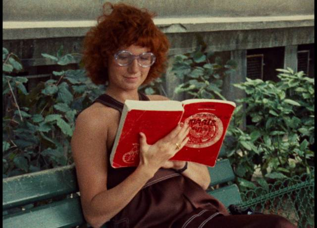 Julie (Dominique Labourier) conjures up a story while reading in a Paris park in Jacques Rivette's Celine and Julie Go Boating (1974)