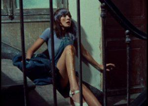 Celine (Juliet Berto) turns up injured on Julie (Dominique Labourier)'s doorstep in Jacques Rivette's Celine and Julie Go Boating (1974)
