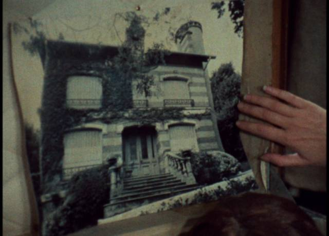 Julie (Dominique Labourier) has an old photograph of the house in a trunk in Celine and Julie Go Boating (1974) ...