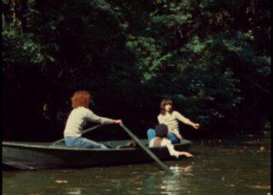 Celine (Juliet Berto) and Julie (Dominique Labourier) take the rescued Madlyn (Nathalie Asnar) boating in Celine and Julie Go Boating (1974)