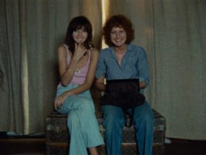 Celine (Juliet Berto) and Julie (Dominique Labourier) watch the unfolding melodrama like a movie which they can't take seriously in Jacques Rivette's Celine and Julie Go Boating (1974)