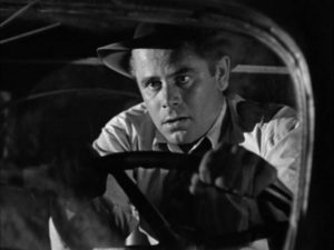 Unemployed engineer Mike Lambert (Glenn Ford) loses his brakes driving down a mountain in Richard Wallace's Framed (1947)