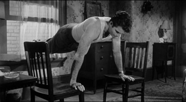 Claude (Vince Edwards) keeps fit as he waits for his next job in Irving Lerner's Murder by Contract (1958)