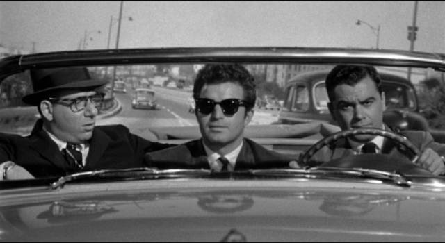 Hired killer Claude (Vince Edwards) insists on sightseeing before making a hit in Irving Lerner's Murder by Contract (1958)