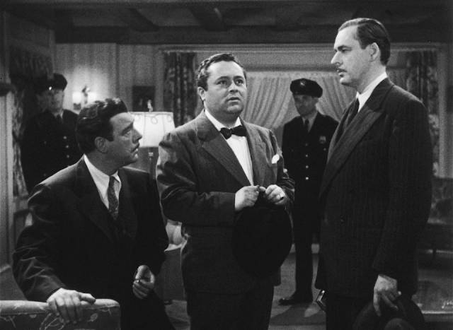 Lawyer Wayne Fletcher (Chaney) distrusts psychic Julian Julian (J. Edward Bromberg) in Wallace Fox's Pillow of Death (1945)