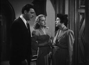Wayne Fletcher (Chaney) and Donna Kincaid (Brenda Joyce) are confronted by eccentric Amelia Kincaid (Rosalind Ivan) in Wallace Fox's Pillow of Death (1945)