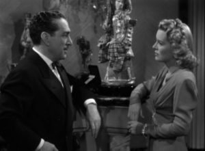 Businessman Roger Graham (J. Carrol Naish) seduces Jeff Carter (Lon Chaney)'s wife Mary (Brenda Joyce) in John Hoffman's Strange Confession (1945)