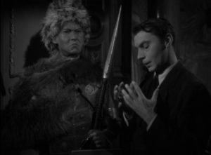 Martin Kosleck as typically deranged waxworks artist Rudi Polden in Harold Young's The Frozen Ghost (1945)